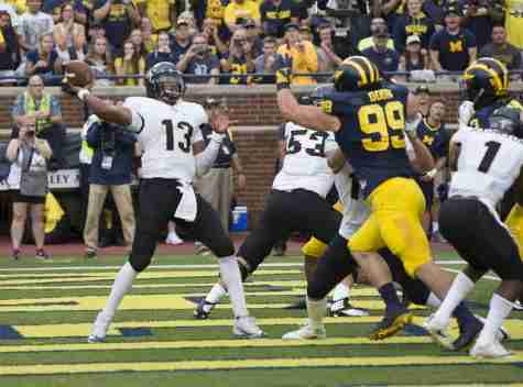 Justin Holman suffers injury as UCF fall to Michigan in The Big House