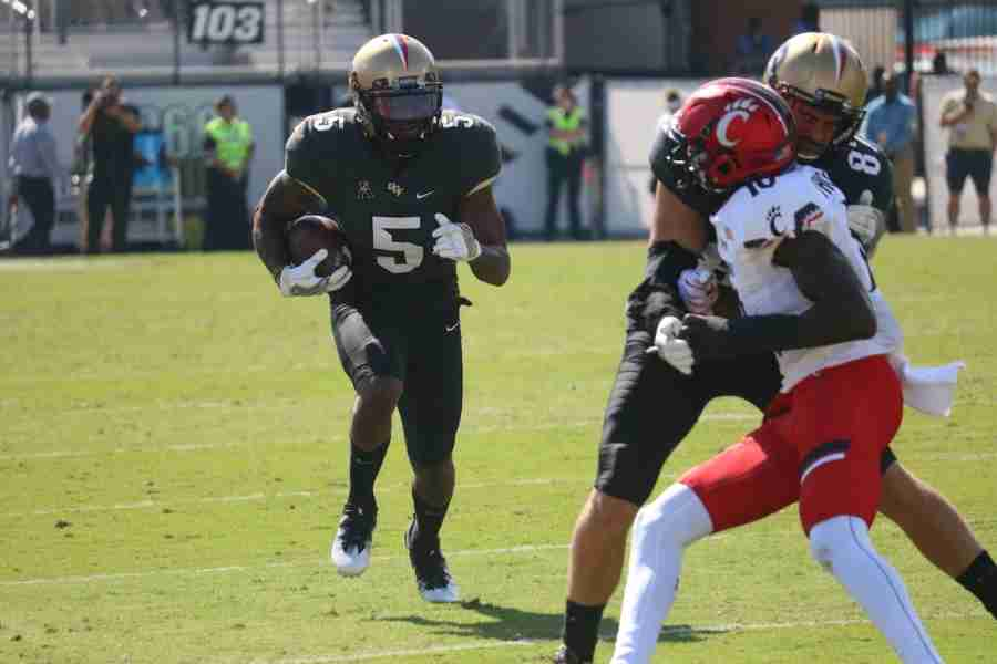 Dredrick Snelson scored the Knights first touchdown of the game on a one-yard reception from McKenzie Milton.