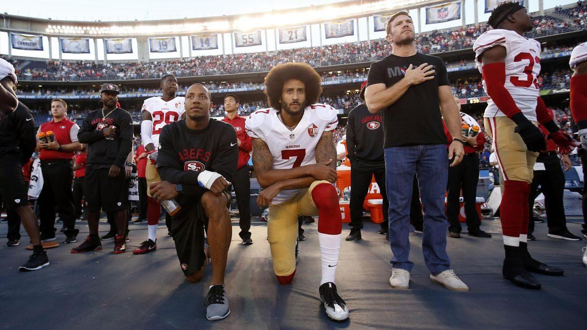 Colin+Kaepernick+%2C+then+of+the+San+Francisco+49ers%2C+takes+a+knee+during+the+national+anthem.