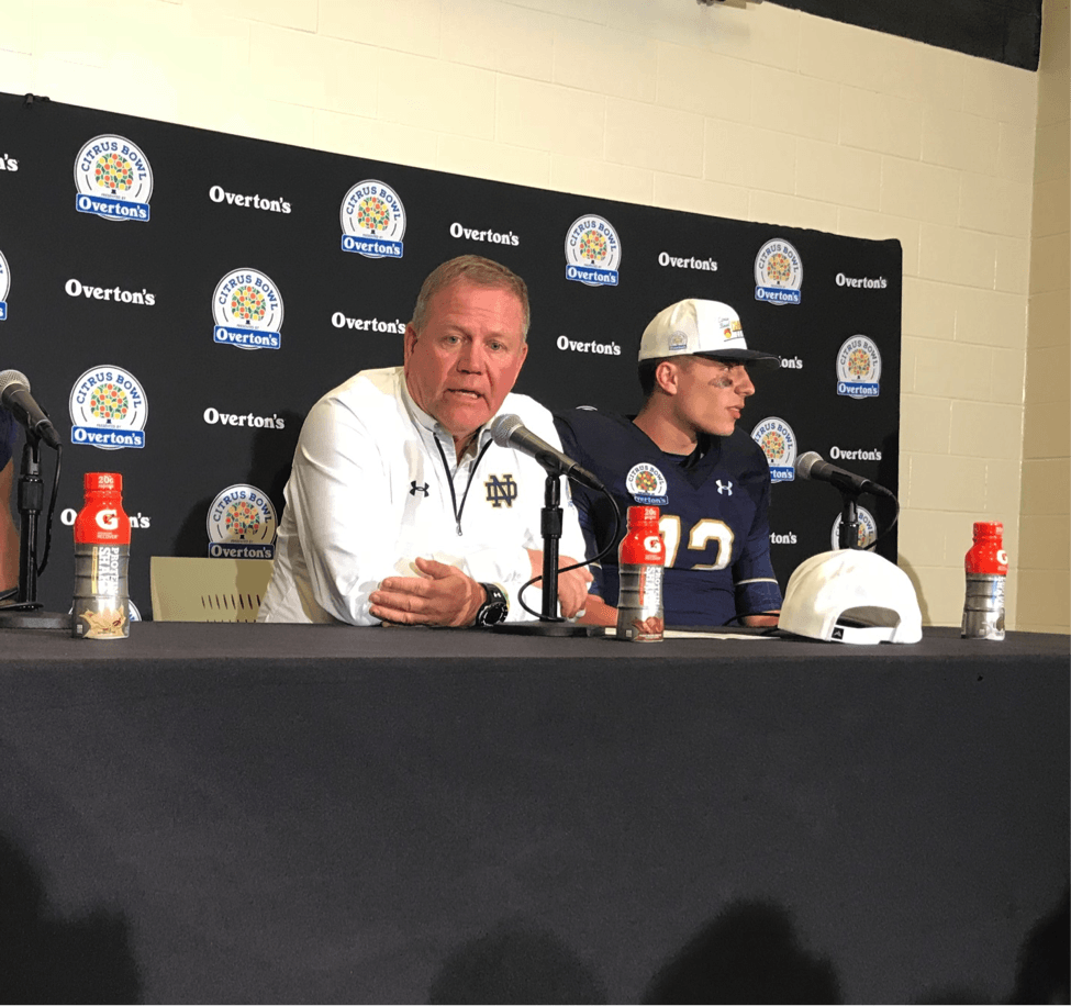 Notre Dame Head Coach Brian Kelly (left) and quarterback Ian Book speak to the media after the Citrus Bowl.