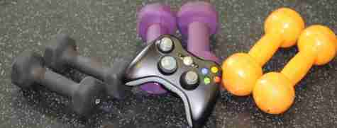 game controller on floor with barbells
